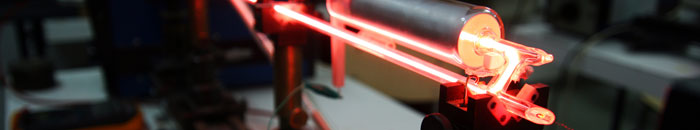 Optically clear adhesive systems for laser applications